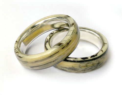 Paper layer wedding bands with silver inlet