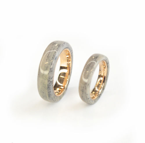 Paper layer wedding bands with 14k gold sleeve